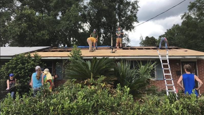 Volunteers rebuild a roof in the Ken Knight Drive community.