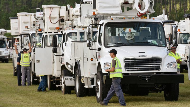 Utility workers stage with their equipment Thursday morning at the Equestrian Center in Jacksonville before heading into the heavily damaged areas in the Panhandle from Hurricane Michael.