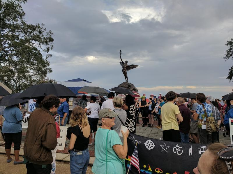 A 2017 vigil in Jacksonville calls for the removal of Confederate monuments from public places.