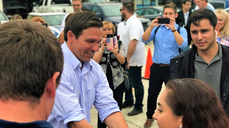 Republican Gubernatorial Candidate Ron DeSantis helps unload a truck filled with supplies for those affected by Hurricane Michael.