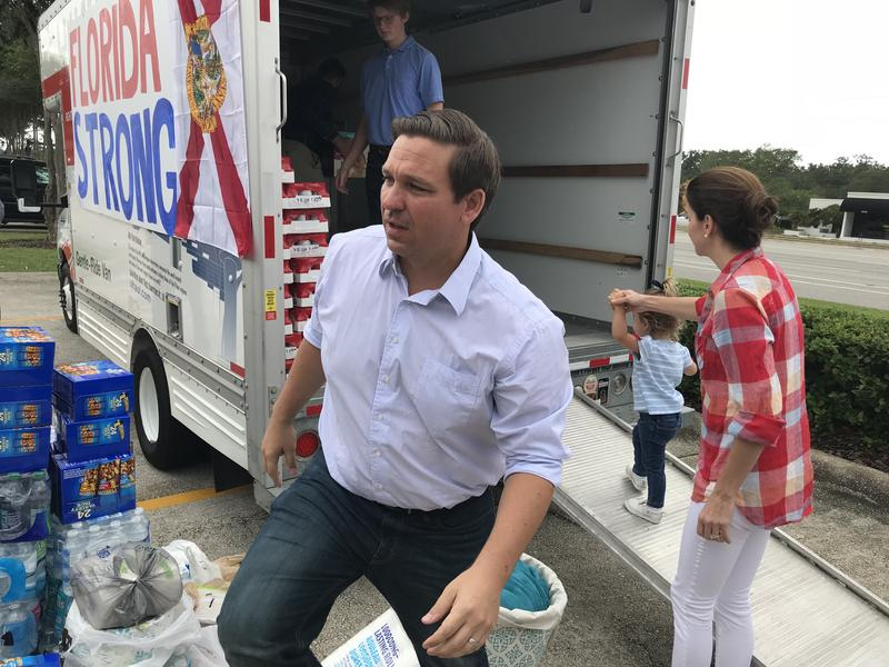 Ron DeSantis, his wife Casey and their daughter Madison help load a Uhaul with supplies for those impacted by Hurricane Michael.