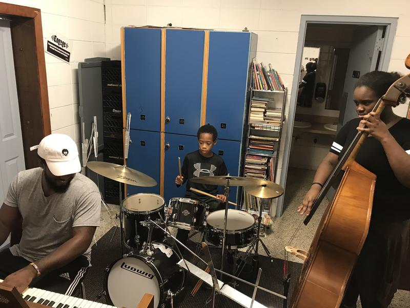 Left to right: Liston Gregory III on piano leading a jazz lesson with Isaiah Mac, 8, on drums and Ayanna Nelson, 13, on bass.