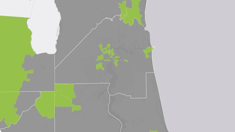 Opportunity Zones in Northeast Florida are shown in green.