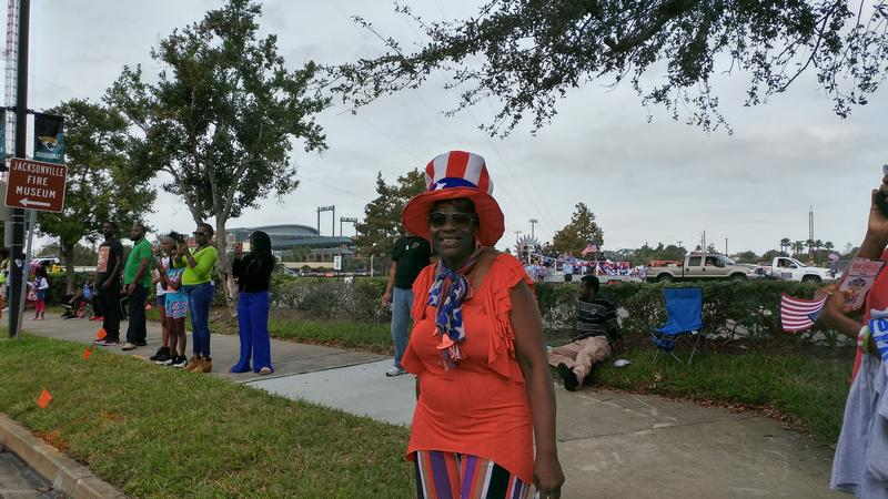 A woman shows her support for the Red, White and Blue at Monday's Jacksonville Veterans Day Parade.