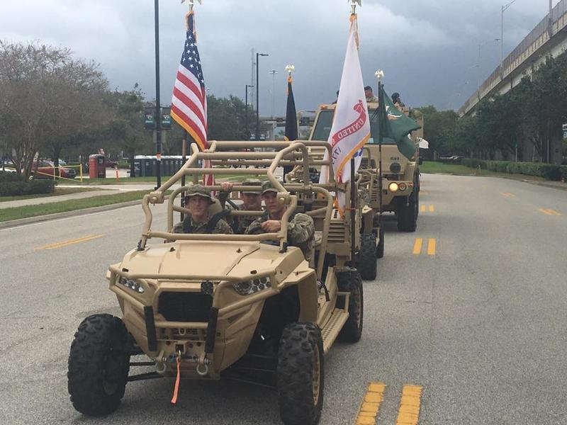 Clouds darkened and the skies opened up at one point during Monday's Jacksonville Veterans Parade.