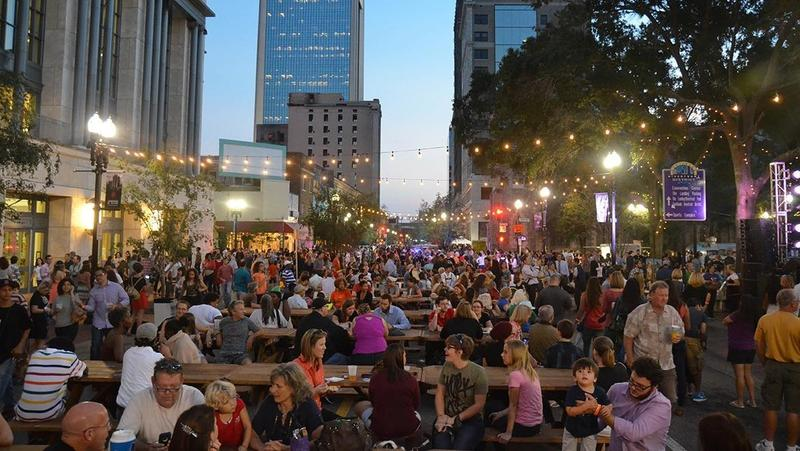 A crowd gathers for the First Wednesday Art Walk in downtown Jacksonville.
