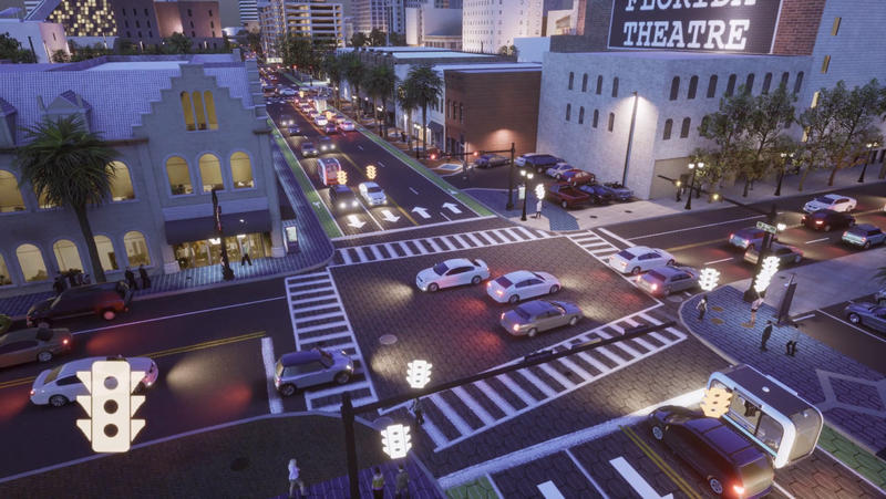 This video screengrab shows a Bay Street intersection that includes solar streets and sidewalks along with autonomous vehicles sharing roadways with traditional vehicles. Watch the full video inside this story.