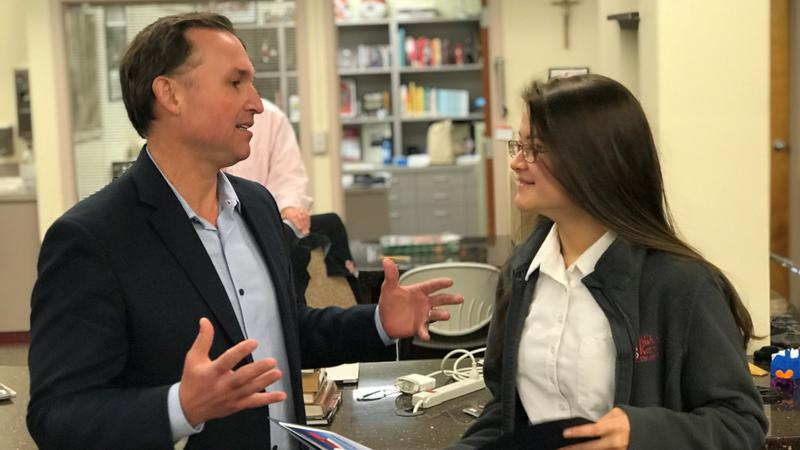 Jacksonville Mayor Lenny Curry giving Bishop Kenny High School 9th-grader Arisa Nakamichi advice after presenting her with a 2019 Tomorrow's Leaders Award.
