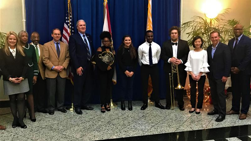 2018 Jacksons' Music Scholarship Fund recipients flanked by city and school officials.
