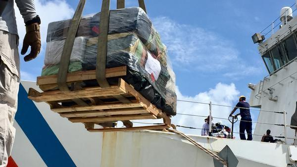 The Coast Guard Cutter James offloads six tons of seized cocaine to authorities at Port Everglades on May 10, 2018.
