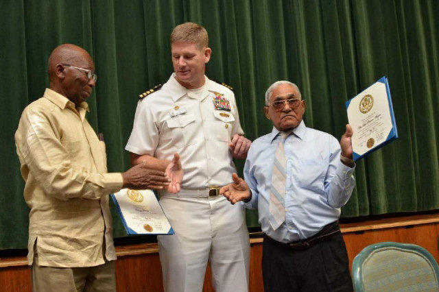 """Navy Capt. John """"J.R."""" Nettleton (center) is pictured in 2012.  The other two men pictured have no connection to the charges leveled against Nettleton."""