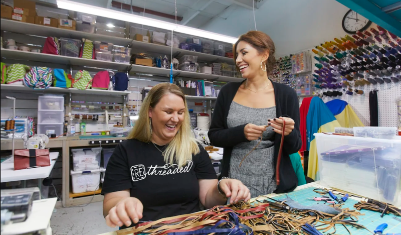 Irina Shabayeva (right) shares a smile with Rethreaded production employee Carrie Smals.