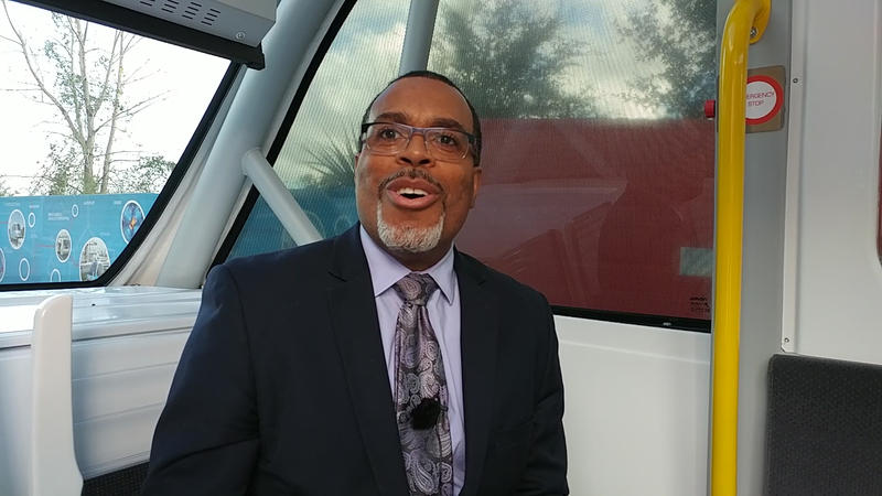 JTA Skyway Senior Manager Harold Samms talks with WJCT News during a ride on the Navya Autonom Shuttle.