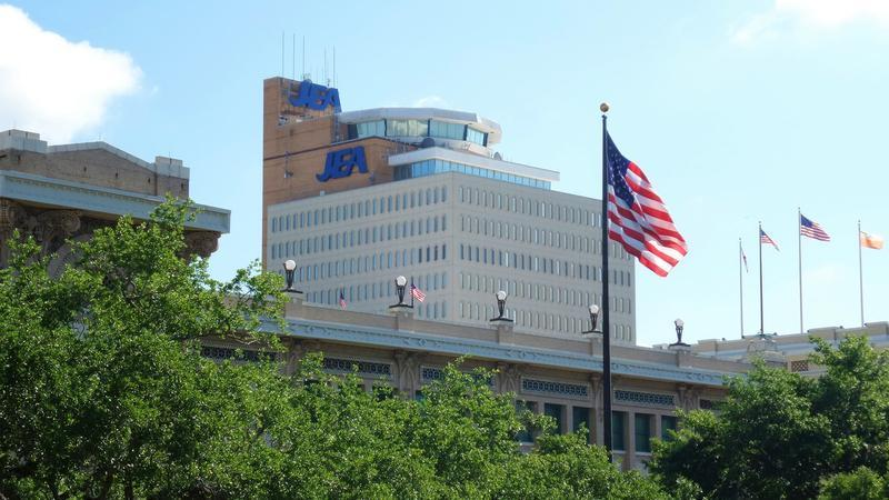 JEA's downtown headquarters is seen in the background with Jacksonville's City Hall in the foreground.