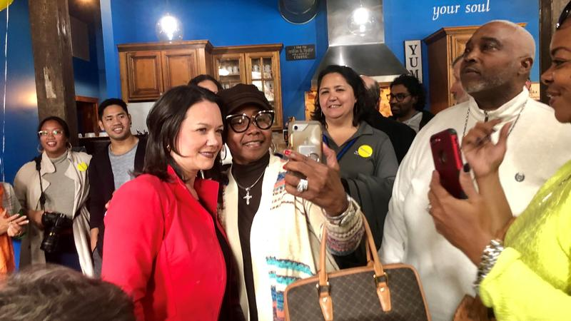 City Councilwoman and mayoral candidate Anna Lopez Brosche poses with a supporter Friday at the Bleu Chocolat Cafe.