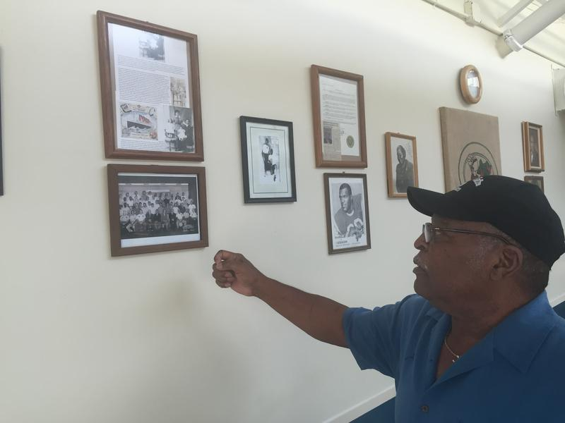 Frank Lyons, the owner of the Point Coffee Shop, explains the significance of the pictures hanging from the walls of his business.