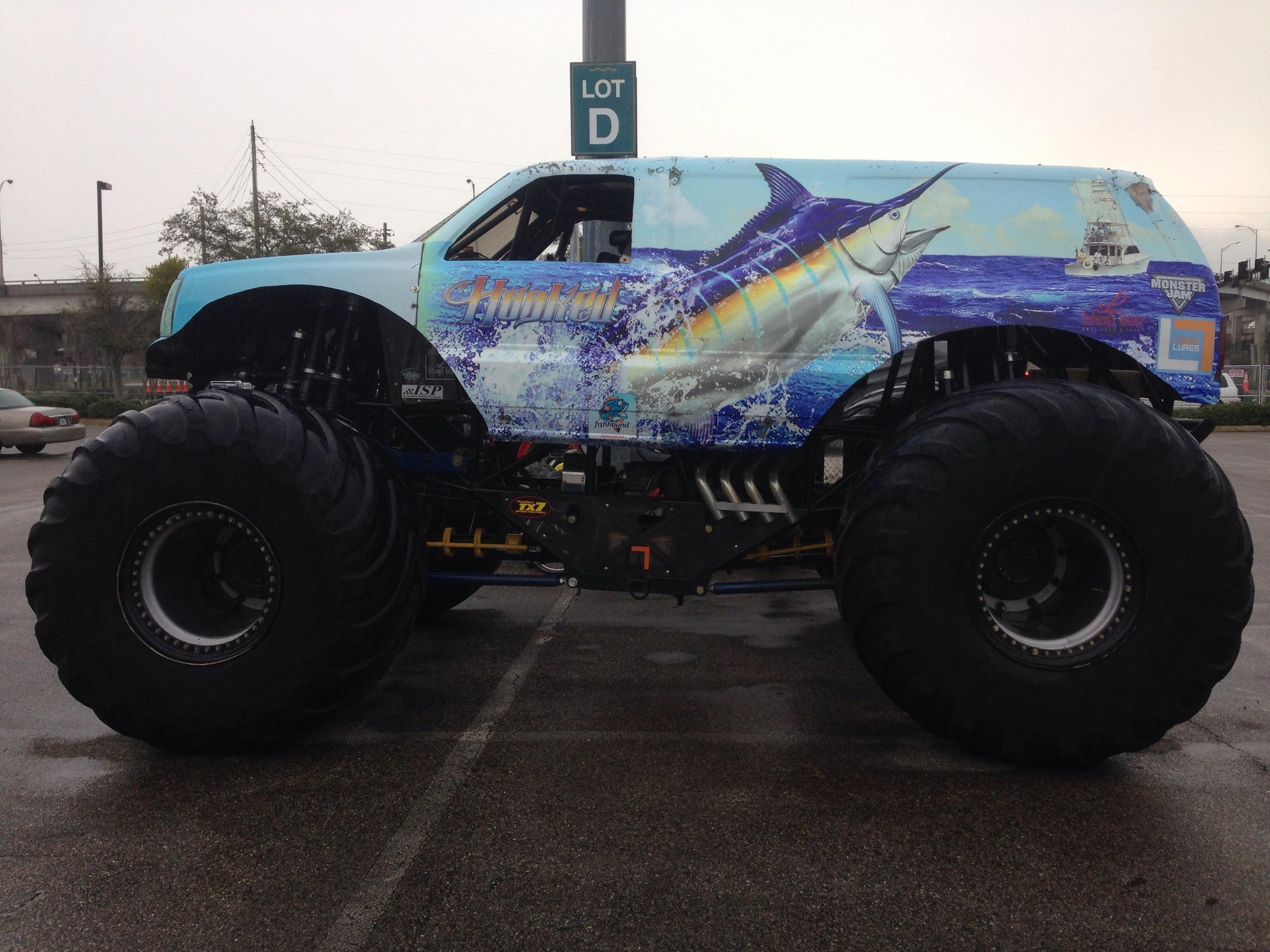 Smash your way to fun with this enormous Monster Truck Combo that towers over 18ft high! Rev your engines this unique combo features a large bounce area, climb and slide, and bright colorful artwork.