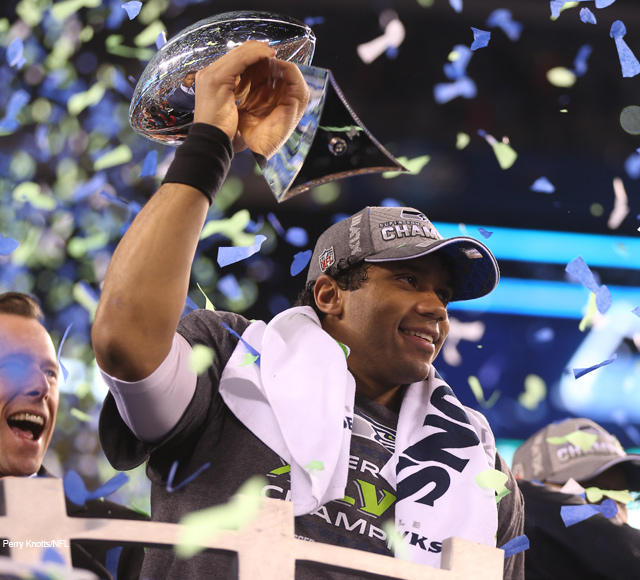 Seattle Seahawks Quarterback Russell Wilson Holds Up The Vince Lombardi Trophy After Helping His Team To Victory In Super Bowl XLVIII