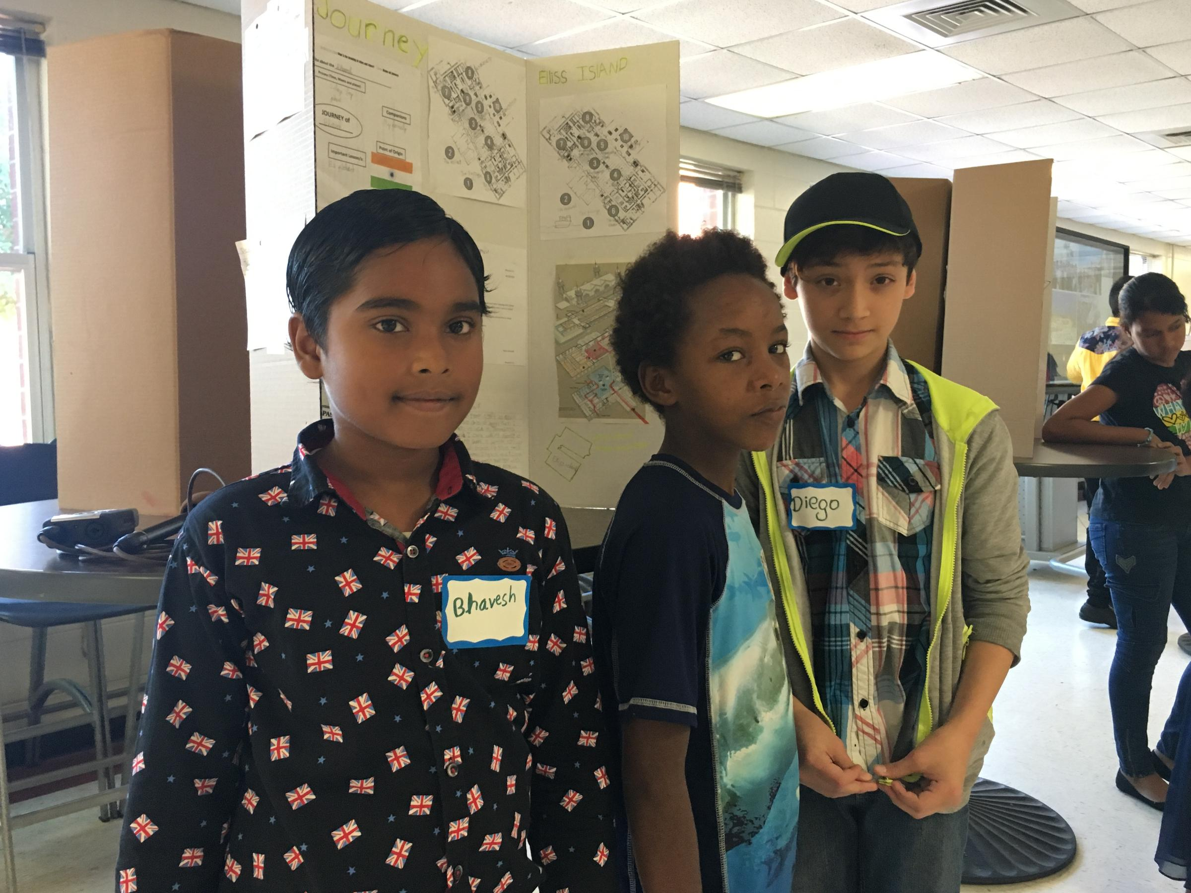 Duval sixth-grade ESOL students Bhavesh Sc, Ahmed Elshaik and Diego Maradia  show off their summer projects at Terry Parker High School, Thursday.