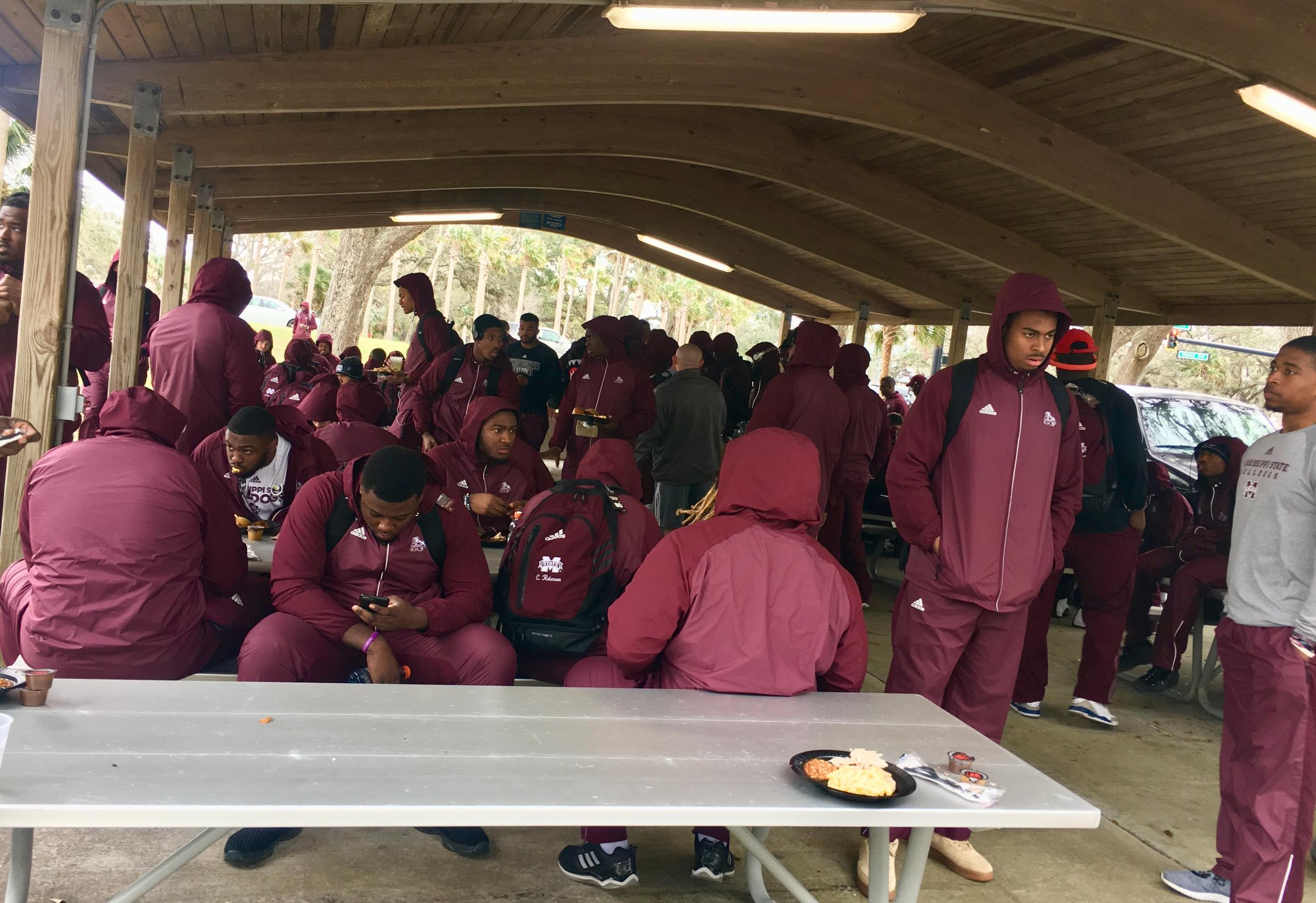 Mississippi State players get a catered barbecue lunch before touring ships at the Mayport Naval Base