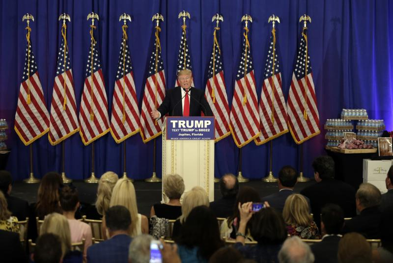 Republican presidential candidate Donald Trump speaks during a news conference at the Trump National Golf Club, Tuesday, March 8, 2016, in Jupiter, Fla. On display on the right is Trump branded water and steak.