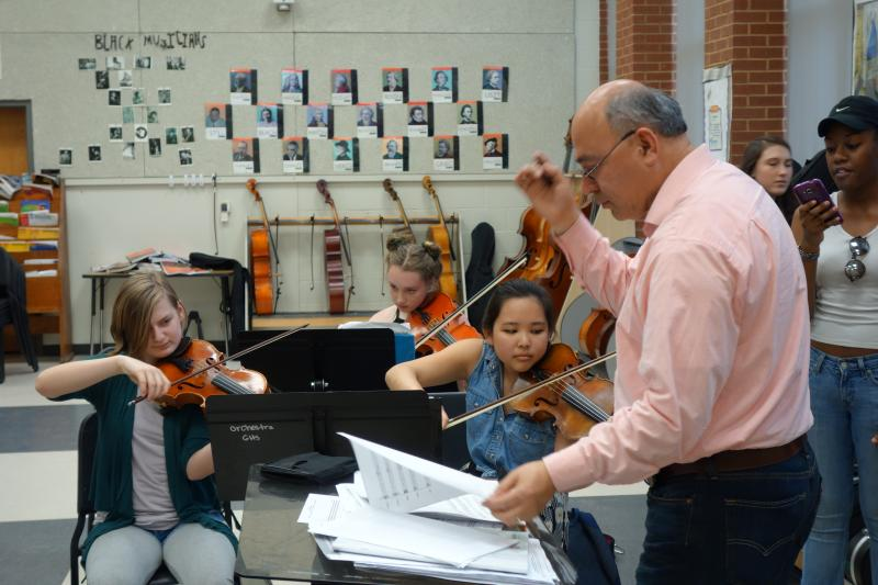 Director Sergio Rodriguez leads the orchestra
