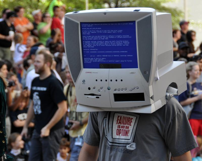 In 2015, Dragon Con attracted 70,000 people over Labor Day weekend. An attendee wears a computer costume in the annual festival's celebrated parade.