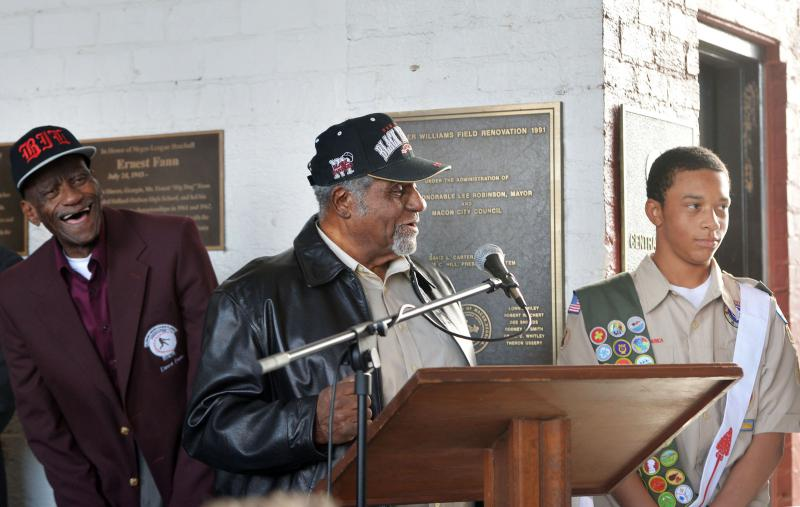 Eagle  scout candidate Gordon Smith, right, is congratulated by two of the Negro League baseball players, Ernest Fann, left, and Robert Scott, center, he helped honor with plaques at Luther Williams Field Saturday in Macon, Ga.