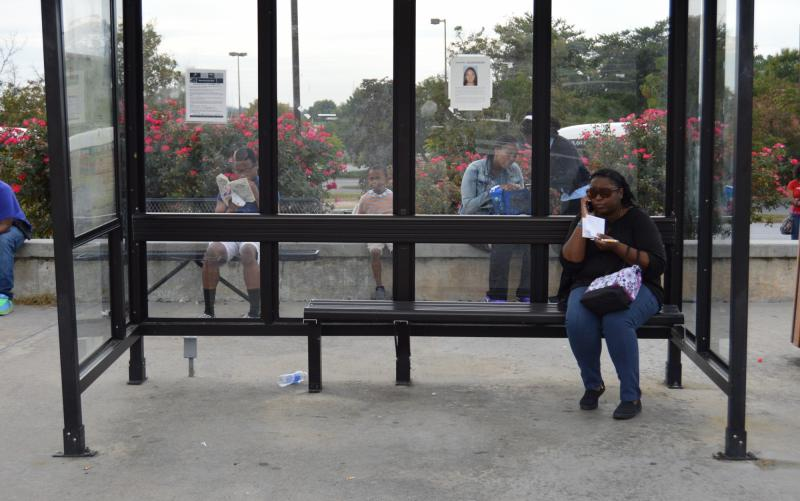 Yvette MacPherson and other commuters waiting for their Gwinnett County Transit (GCT) bus.