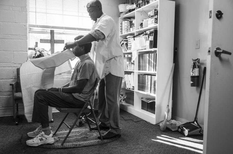 Anthony Ponder gets ready to give a hair cut on a Sunday morning at Centenary Church in Macon. Barbering has been at the center of Ponder's life whether in prison or out.
