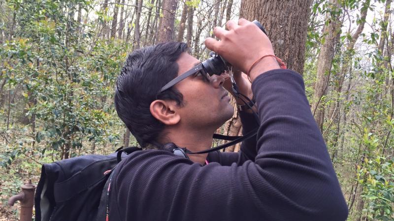 Vinod Babu helps  lead a bird watch near the Fernbank Museum in Atlanta on March 19, 2016.