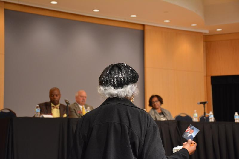 Bernice Smith telling members of the kinship care study committee about raising her grandson, Stephen, picture in hand.