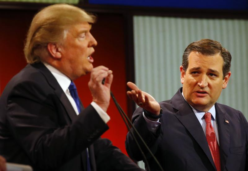 Republican presidential candidates, businessman Donald Trump and Sen. Ted Cruz, R-Texas, argue a point during a Republican presidential primary debate at Fox Theatre, Thursday, March 3, 2016, in Detroit.