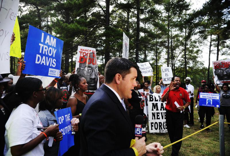 Media members gathered to watch the protest of the impending execution of Troy Davis in 2011.