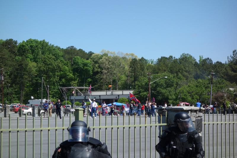 Police surround the fenced in Confederate rally.