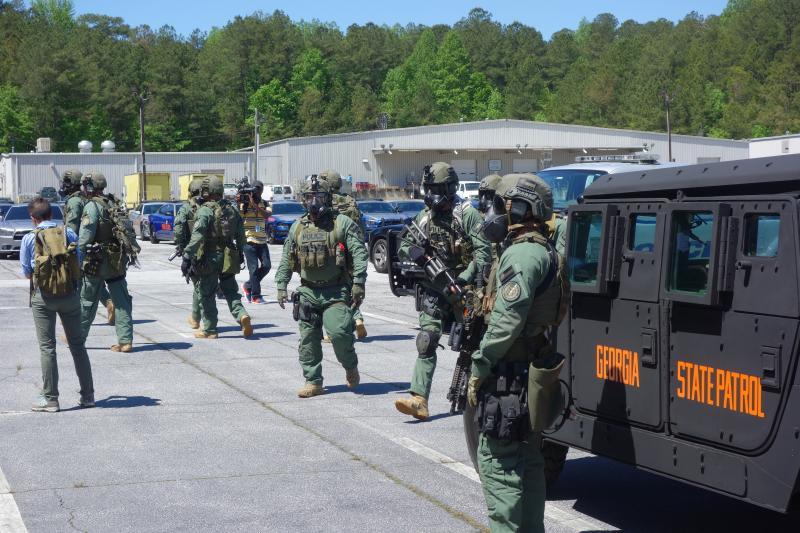 SWAT teams block the counter protestors.