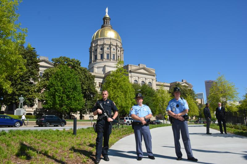Members of the Georgia State Patrol gather to keep an eye on the rally.