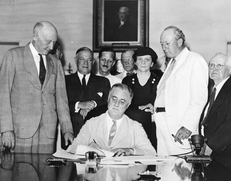 President Franklin D. Roosevelt signs the Social Security Act into law on August 14, 1935.