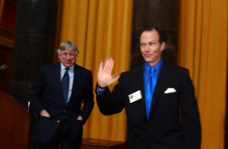 Columbia University President Lee C. Bollinger (left) presents Mike Luckovich with the 2006 Pulitzer Prize in Editorial Cartooning