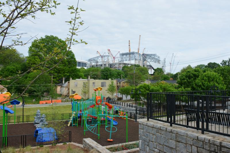 Mercedes-Benz Stadium rising over the recently completed Vine City Park.