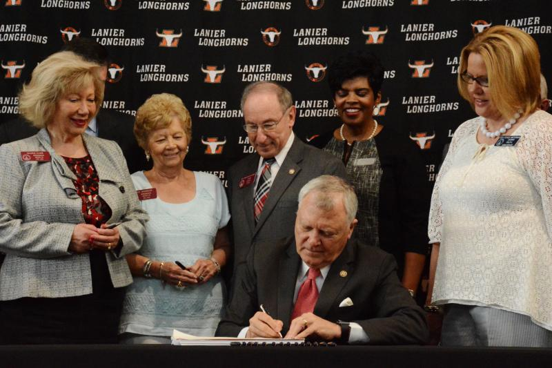 Governor Deal signed the fiscal year 2017 budget at Lanier High School in Buford, Georgia surrounded by state lawmakers.