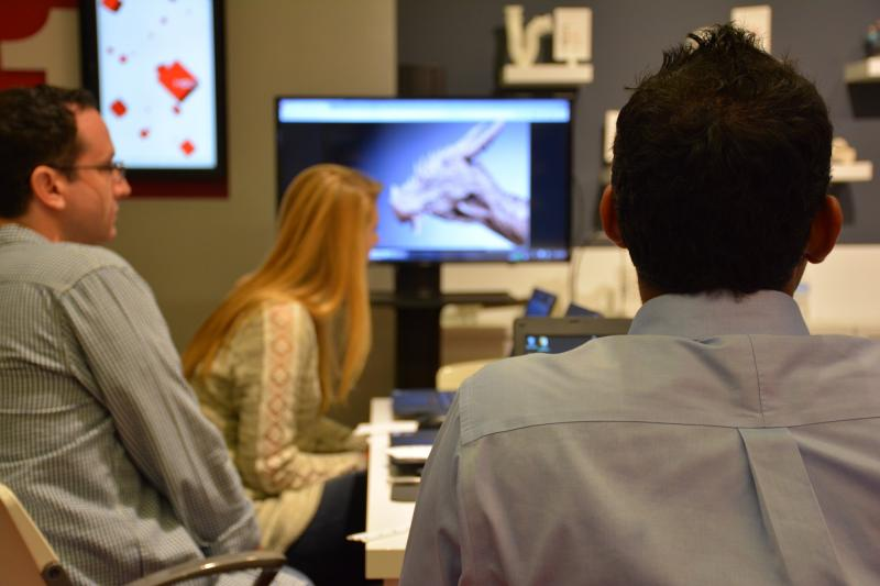 Students engrossed in a demonstration of the power of 3-D modeling and printing at the Museum of Design Atlanta.