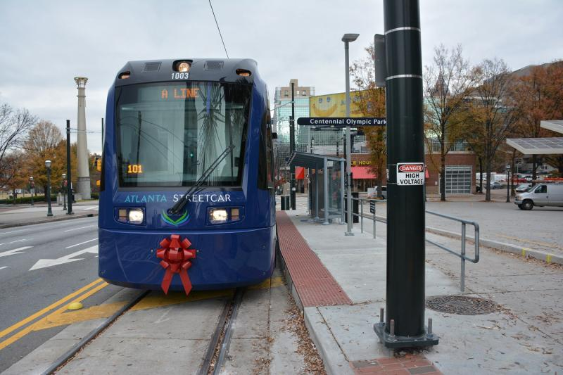 The Atlanta Streetcar waiting at the Centennial Olympic Park stop for passengers to board.