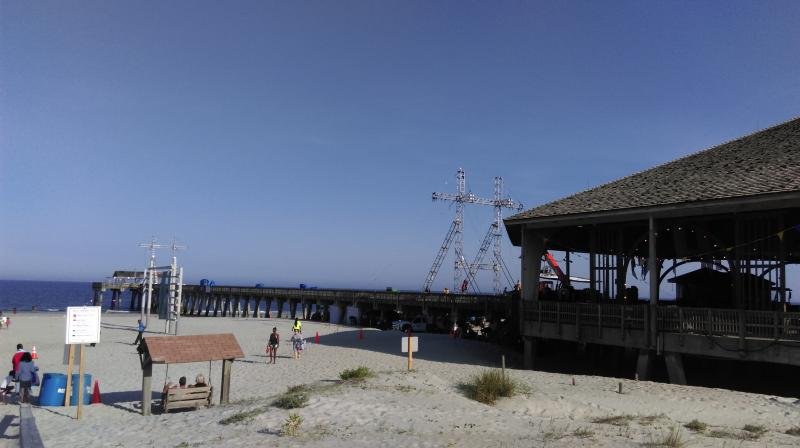 """The """"Baywatch"""" filmmakers closed the pier and part of the beach on Tybee Island, and rigged equipment to shoot a motorcycle scene down the pier."""