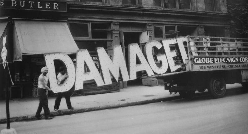 Evans often playfully juxtaposed text and image in his work. For this photograph, Evans captured a seemingly oxymoronic sign as men loaded it onto a New York City truck.