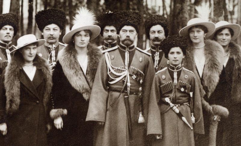 The Romanovs visiting a regiment during World War I. From left to right, Grand Duchess Anastasia, Grand Duchess Olga, Tsar Nicholas II, Tsarevich Alexei, Grand Duchess Tatiana, and Grand Duchess Maria, and Kuban Cossacks circa 1916.