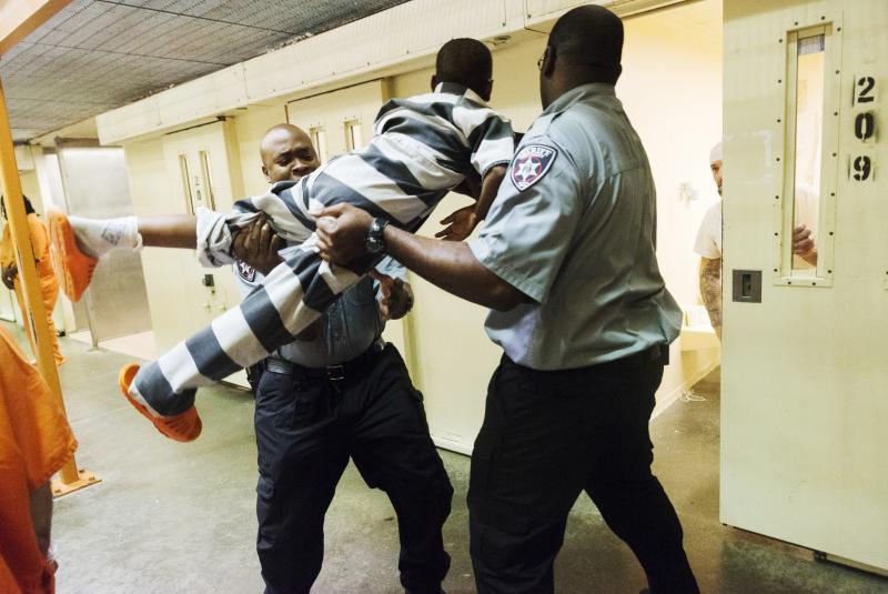 A nine-year-old boy is lifted and forced through a cell door at the Bibb County Jail during the Consider the Consequences youth intervention program recently.