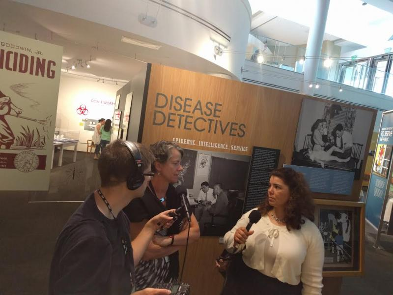On Second Thought producer Sean Powers and host Celeste Headlee meet with Mary Hilpertshauser, the historic collections manager at the CDC's museum.