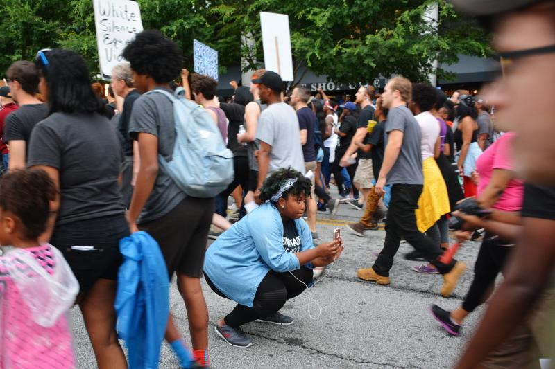 Activist Aurielle Lucier using her smartphone to stream Monday's protest in Atlanta.