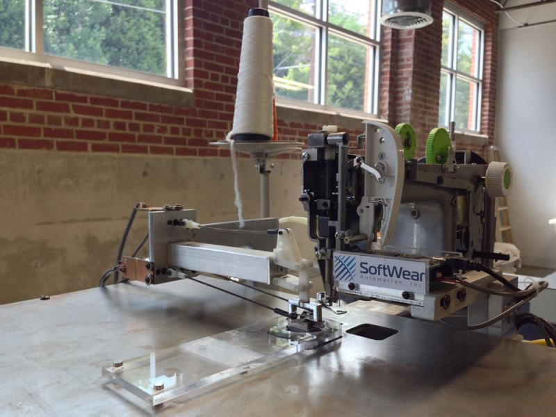 Robotic sewing machines, like this one created by SoftWear Automation, could change the garment industry and bring jobs back to Georgia.
